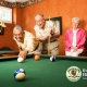 3 people playing cutthroat pool